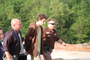 ©2009 NCL Magazine : Photo By Tommy Stafford : Austin Griffin being led to a Nelson County Court last month on the day of his arrest May 11th.
