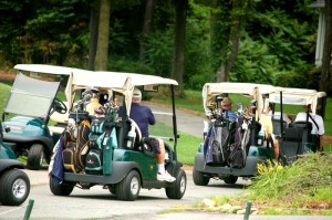 Golfers head to the course at Monday's tournament.