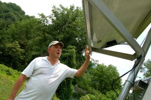 ©2009 NCL Magazine : Photos By Yvette Stafford : Weather enthusiast Kevin Rose, checks his solar panel used to power his Rockfish Weather Station in Eastern Nelson County, Virgina
