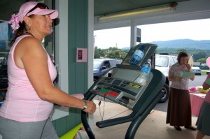 Photo By Yvette Stafford : ©2009 www.nelsoncountylife.com : Sandy Etchison spent her Saturday on this treadmill in front of Stoney Creek Pharmacy training and raising money for her 60 mile October walk.