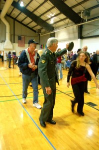 A veteran waves thank you to the students at RRES Wednesday morning.