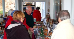 Bobby Rose shows off a small part of his extensive Dickens Village display as part of The Christmas House Tour.