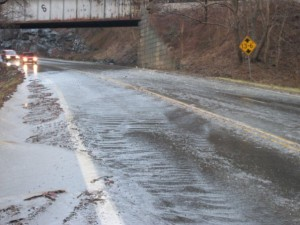 Photo By Jennifer Anderson Smith : Water & gravel rush across Route 250 headed up Afton Mountain near the railroad bridge. Several accidents occurred on 250 due to the flooding.