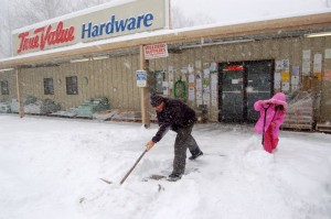 All Photos ©2010 www.nelsoncountylife.com : By Tommy Stafford : Danny Watson co-owner of Wintergreen Hardware in Nellysford, Virginia shovels snow with daughter Noel early Saturday morning. Click any photos to enlarge.