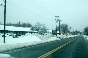 Photo By Tommy Stafford : ©2010 www.nelsoncountylife.com : Snow is banked up in the parking lot and along Route 151 in Nellysford Many primary roads are in good shape, but many back roads are still very hazardous.