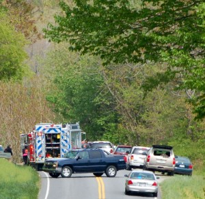 Photo By Tommy Stafford : ©2010 www.nelsoncountylife.com : Emergency vehicles block the roadway of a three car accident on Route 151 just north of Nellysford Tuesday afternoon.