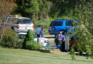 Nelson County Sheriff, David Brooks on right in the blue shirt, speaks with his investigators on the scene Wednesday evening.