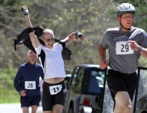 Ray Legge, of Winchester puts on his lifejacket as he completes the running portion of the Piney River Mini Triathlon.