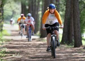 Kelton Walker, 15 of Lovingston bikes down the Blue Ridge Railway Trail heading to the finish of the Piney River Mini Triathlon.