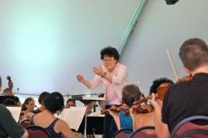Photo By John Taylor : Guest conductor Mei-Ann Chen, internationally renowned conductor, leads the Wintergreen Festival Orchestra during a rehearsal session this past weekend at Wintergreen.