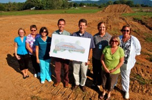 Most of the staff from the current Afton Family Medicine Clinic poses on the lot of what will be their new location in 2011.