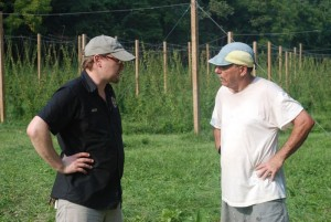 Head Brewmaster, Jason Oliver (left) from Devils Backbone Brewing talks with David Bernard at his Madhops Farm. Jason purchased some of the hops for use in his wet hop brew called Blue Ridge Hop Revival. It will be ready in about a month.