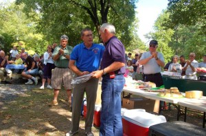 Photos By Tommy Stafford : ©2010 www.nelsoncountylife.com : Eddie Embrey (left) President of The Emergency Services Council & Faber Fire Chief, congratulates Milton Harris on 40 years of volunteer service with the Lovingston Fire Department at this past Sunday's (9.12.10) Appreciation Day held at Lake Monacan in Nellysford, Virginia. Click on any photo to enlarge.