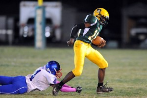 Tyler Vest, a NCHS sophomore, (18) eludes a tackle fromShaq Pannell , a junior at Dan River(4)