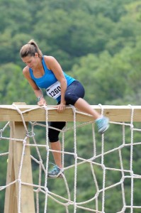 Yvette's buddy and teammate Monica from Crozet, VA scales one of the numerous obstacles at Go Ruck Nasty this past weekend at Massanutten, VA