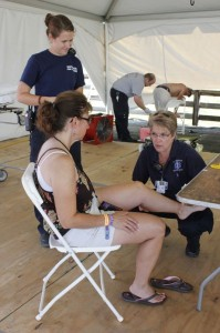 Betsy Smith with WF&R (kneeling right) tends to a minor injury at the 2013 Lockn' Festival.
