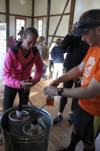Steve Troyae (right) rewards himself after the race with a well deserved brew from Devils Backbone. All runners we treated to homemade chili and brews after the race.