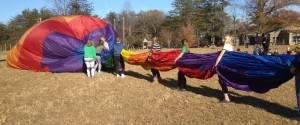Photos Courtesy of NBS: North Branch students help Scott Cohrs, owner and chief pilot of Bonaire Charters, deflate a hot air balloon this past Monday - November 11, 2013 as part of a lesson in physics for students there.