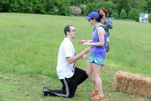 ©2014 Blue Ridge Life Magazine : Photos By BRL Mountain Photographer Paul Purpura : Patrick Zinni of Charlottesville ends the DB Steeplechase race in a most unusual way this past Saturday with a mariage proposal to his sweetie, Mallory Vander  Kooy, also of Charlottesville.