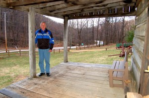 Mr. Mansfield in March of 2008 on the porch of the old Dodd Cabin he purchased and eventually restored.