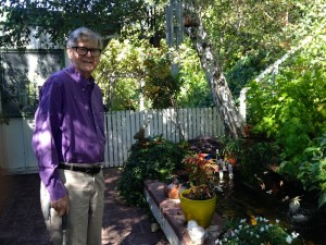 91 year old Earl Hamner originally of Schuyler, VA stands near his KOI pond in the backyard of of his home in Studio City, CA this past week.