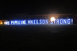 Copyright 2015 Blue Ridge Life : Photo By Woody Greenberg : Members of the No Pipeline movement hold a lighted sign facing US 29 outside Nelson County High School in Lovingston, Virginia - Thursday night January 14, 2015.