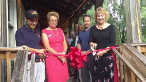 ©2015 Blue Ridge Life Magazine : Photos By Tommy Stafford : (L to R) Danny Wolf, head brewer at Wild Wolf, Julia Rogers, Nelson Chamber President, Troy Berge, Wild Wolf General Manager and Mary Wolf - Owner make it official late Tuesday afternoon - July 21, 2015 as they cut the ribbon to signify the opening of their new event center.