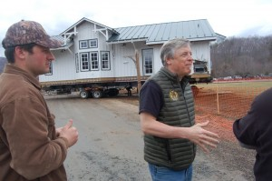 Steve Crandall (right) founder of Devils Backbone and his son Justin Crandall on the left in March 2015 when the old Arrington Depot was being moved from one side of the property to another.