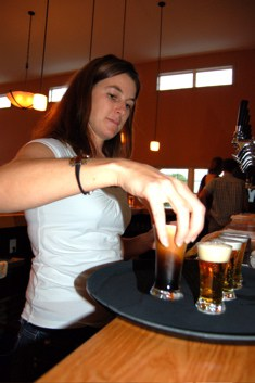Photo By Tommy Stafford : Mandi Smack, co-owner of Blue Mountain Brewery, prepares a sampler tray of all of the beers they make at their newly opened brewery in Afton back on October 24, 2007.
