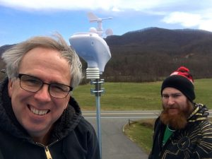 ©2017 Blue Ridge Life Magazine : BRL Publisher and Forecaster Tommy Stafford (L) and Clayton Witte with Ski Barn stand atop the roof at The Ski Barn at the Route 151 and 664 intersection Friday afternoon after the installation of the latest WeatherNow station. March 17, 2017