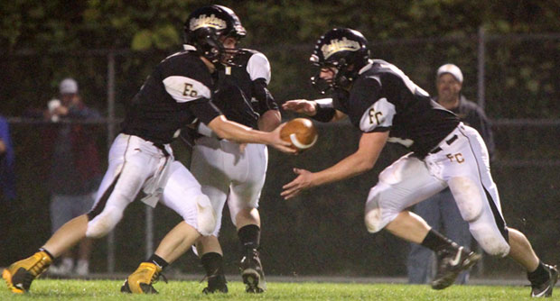 Floyd QB Matt Bary hands off in a drive that ended a few plays later in an interception in the second quarter.