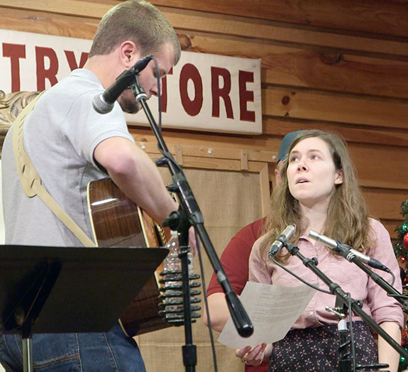 Elizabeth LaPrelle (right) and Stuart Scales perform seasonal music.