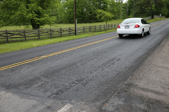 "The rut-laced and decaying ""slurry seal"" on U.S. 221 north of Floyd."