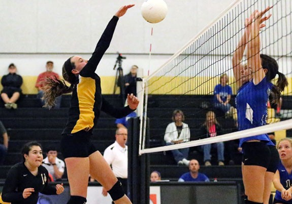 Junior Varsity volleyball action against Auburn.