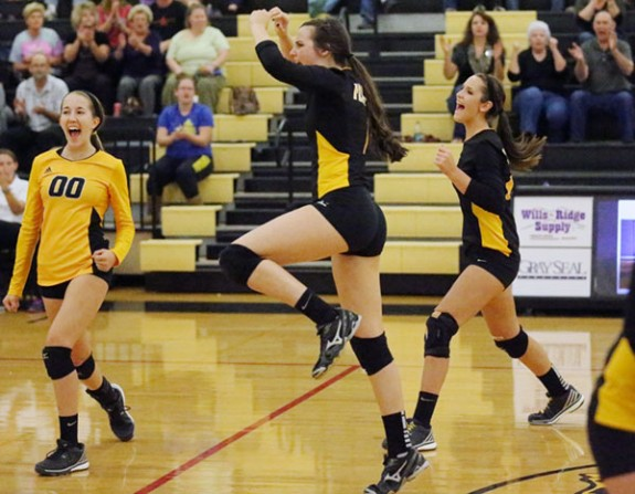 Members of the Floyd County High School varsity volleyball team celebrate a hard-earned point in their game against Auburn on Wednesday night. (All photos from Doug Thompson)