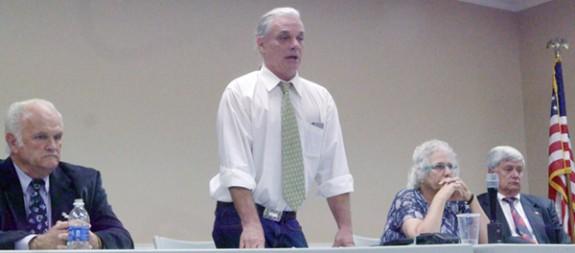 Supervisor Kerry Underwood speaks as Joe Turman (left), Linda DeVito Kucinich and Eddie Worth (right) wait their moment.