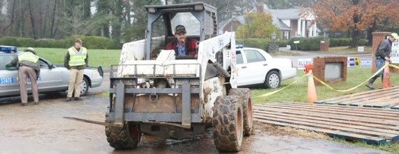 Covering the mud at Rescue Squad Station 1 -- polling place for Little River District. (Photos by Doug Thompson)