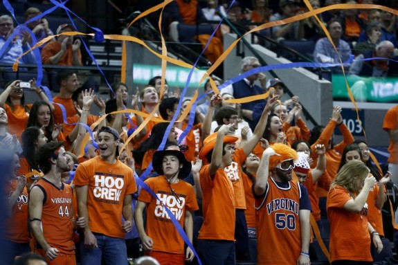 Virginia fans cheer at a basketball game while athletic directors defend charging students fees by citing what sports offer campus life. (Ryan M. Kelly/AP)