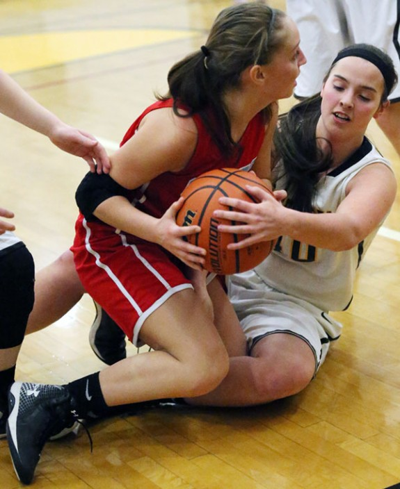 Lily Pratt fights for the ball against Giles (Photos by Doug Thompson)