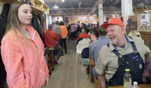 Musician Ben Silcox, moderator of the Sunday Bluegrass Jam at The Floyd Country Store, is talked into heading for the dance floor at the Jamboree.