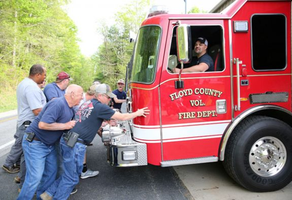 "In a firehouse tradition, members of Station 3 help ""push"" the new Tanker into its new home."