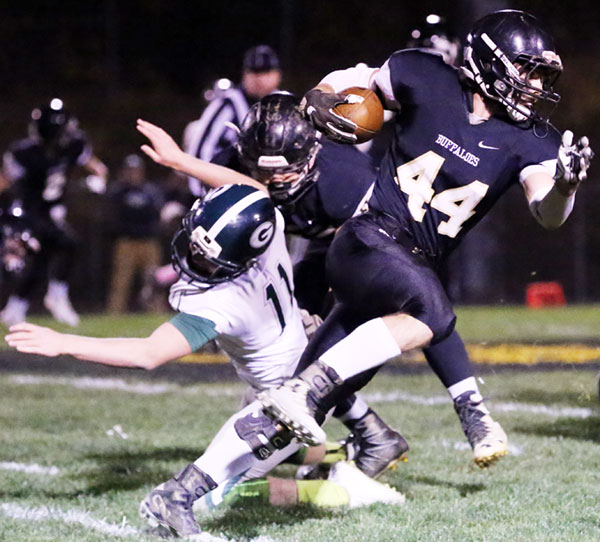 Zack March heads for a touchdown for the Buffaloes. (Photos by Doug Thompson)
