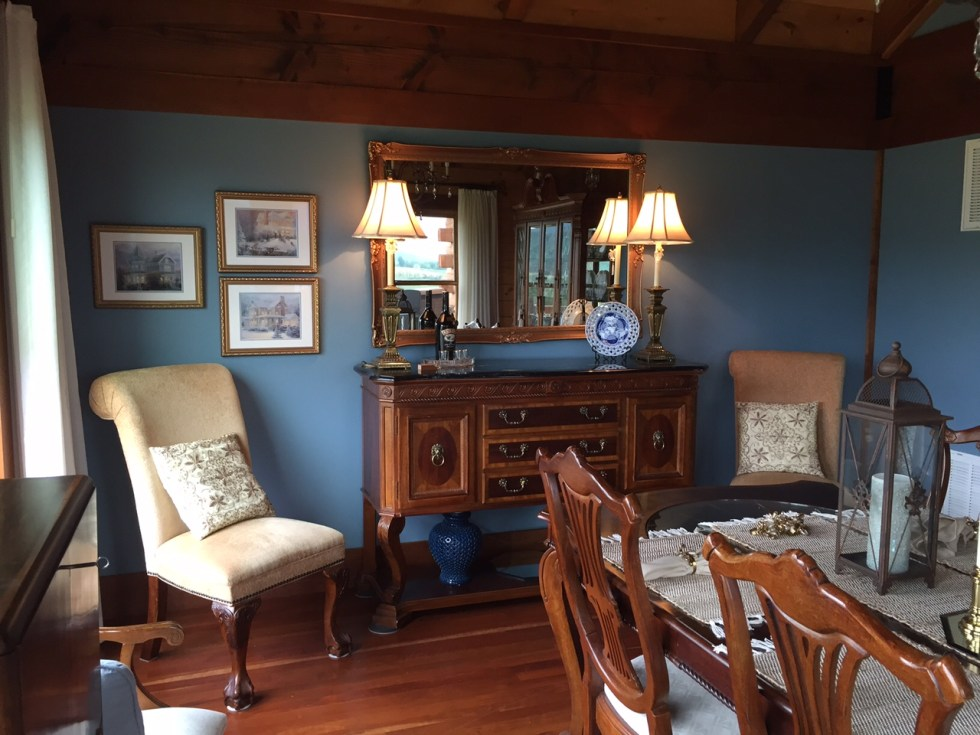 After: This wood in this dining room was enhanced with a blue paint color.