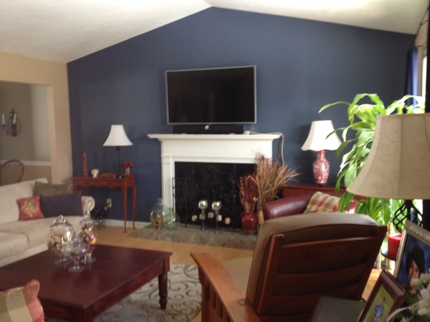 This navy blue accent wall makes the beige feel more updated.