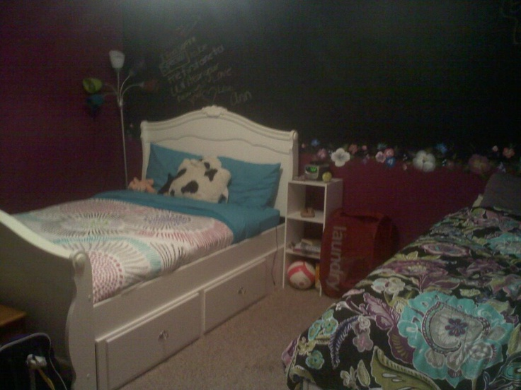This bedroom is shared by two teenage girls. Each chose her own bedding that coordinated, and the walls were painted to work with both. A section of wall was done with chalkboard paint, then I handpainted flowers to border the chalkboard area.
