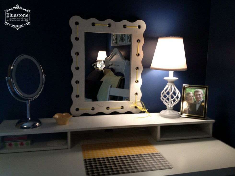 This homework area also has mirrors and lighting to double as a vanity space in a teen girl's bedroom.