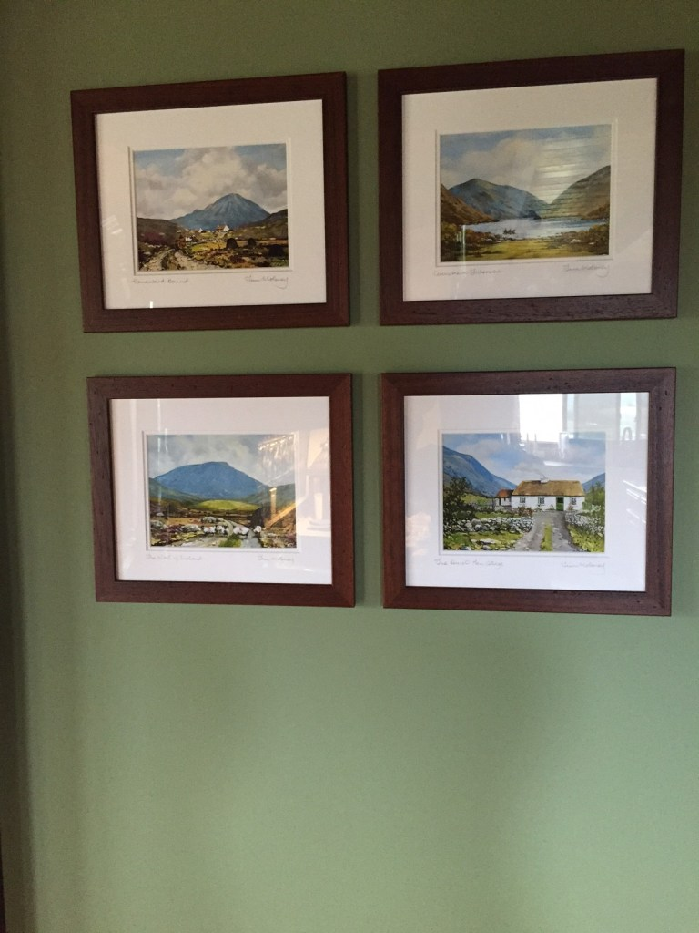 By using the green, the landscapes in this Irish art that belonged to the homeowner brought these prints to life.
