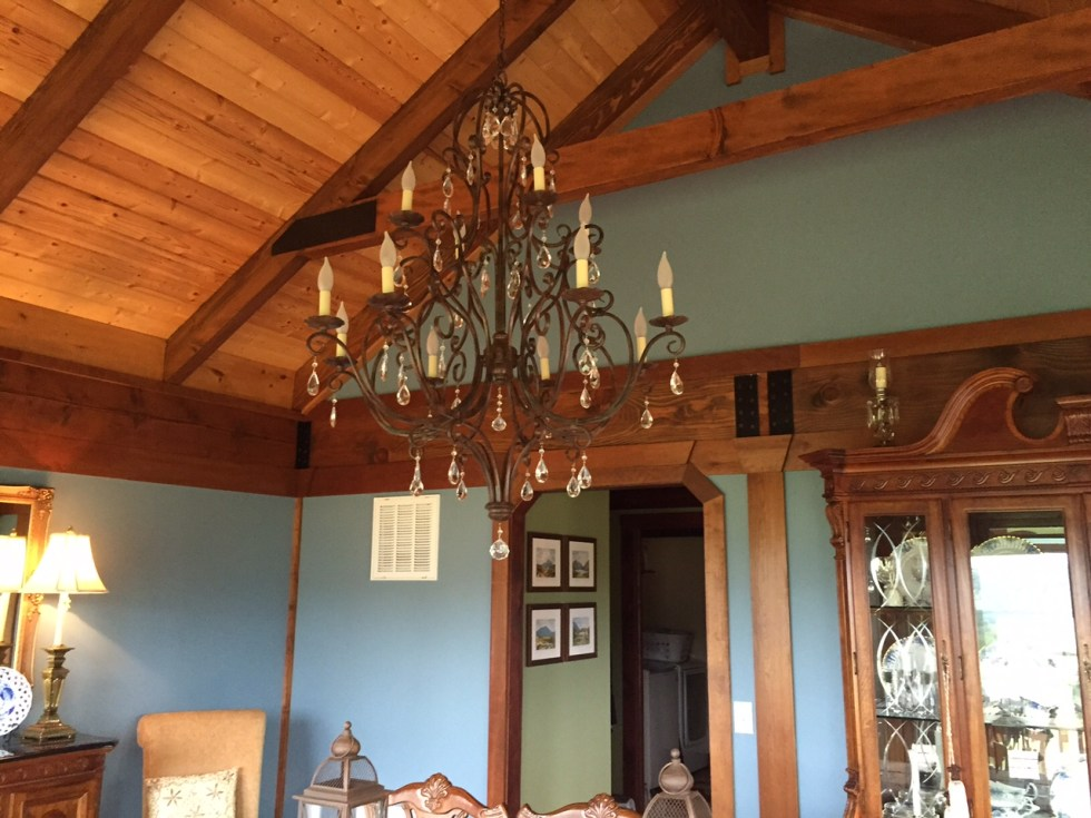 This stunning chandelier sets the more formal tone of the dining room in this custom log home.