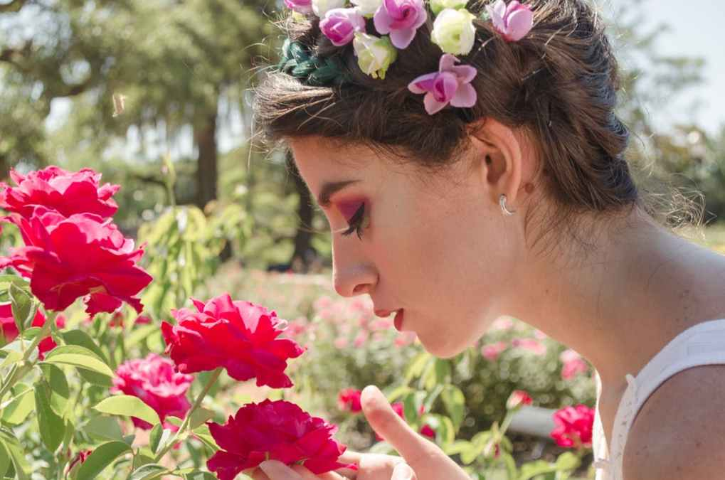 woman-smelling-roses