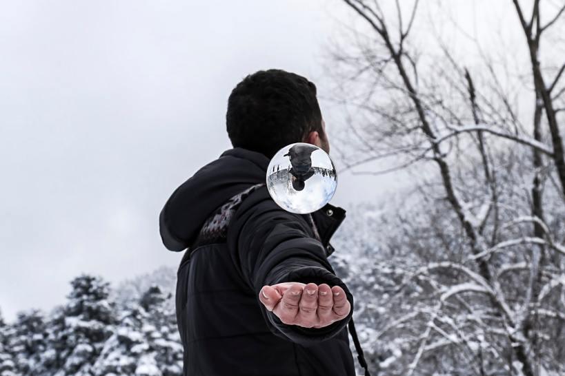 a magician levitating a crystal ball
